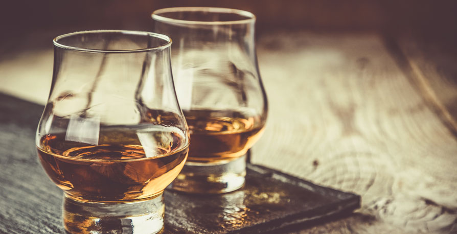 Two glasses of bourbon whisky.